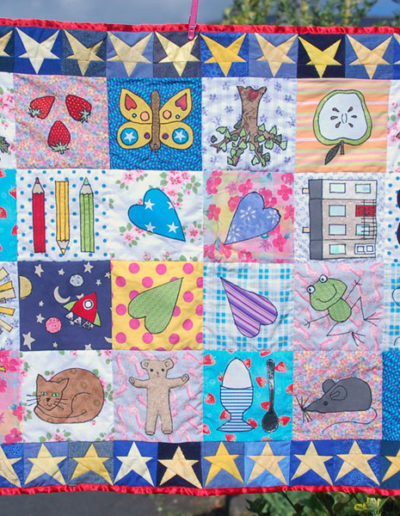 Pippin's quilt- machine appliqued and pieced quilt used as end paper design