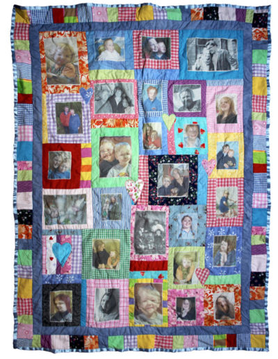 Memory quilt made from recycled fabrics and featuring transferred family photographs.