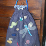 Lined drawstring pump bag appliqued with insects
