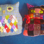 Owl and pussycat cushions, recycled velvet and dressmaking scraps
