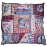 Memory cushion made from child's old clothing and featuring transferred photographs and hand-embroidered facsimiles of child's artwork