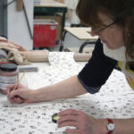 Hand-colouring screen printed slip transfers