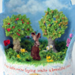 Bisque-fired stoneware sculpture, hand painted, varnished and featuring needle felt hare