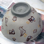 Slip cast bowl decorated with screen printed transfers. Ready for firing.