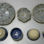 Press-moulded plates and slip cast bowls all slip decorated and glazed